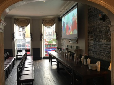 Private room for events with big screen, bar and sound system